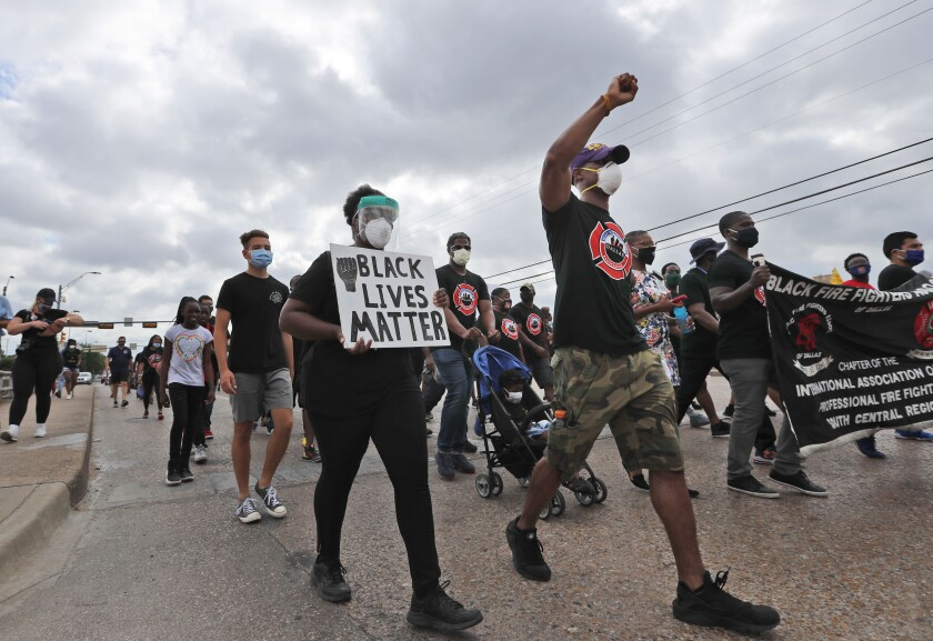 Protesters march in a Black Lives Matter demonstration organized by the Dallas Black Firefighters Association on Juneteenth 2020 in Dallas, Friday, June 19, 2020. Juneteenth marks the day in 1865 when federal troops arrived in Galveston, Texas to take control of the state and ensure all enslaved people be freed, more than two years after the Emancipation Proclamation. (AP Photo/LM Otero)