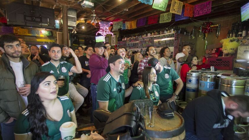 Soccer fans watch the Mexican national team face off against Sweden in a World Cup match at the Machete Beer House in National City on June 27, 2018. National City leaders hope to attract more breweries to the South County city.