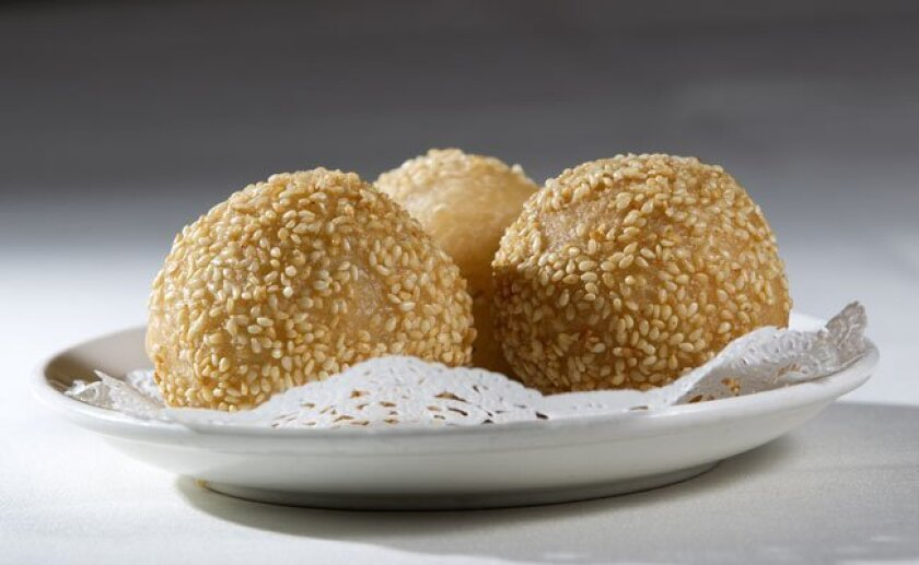 The fried sesame balls at Emerald Restaurant: There's a not-too-sweet dab of red-bean paste inside.