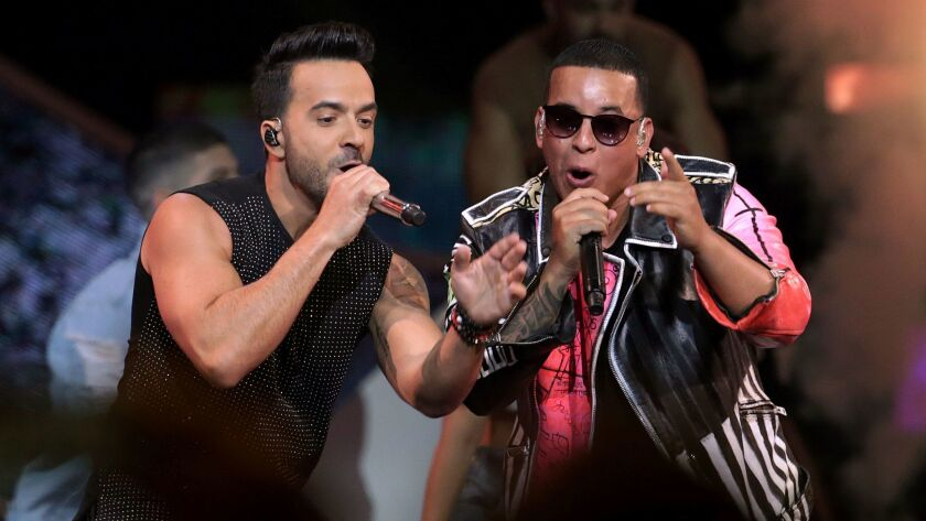 Luis Fonsi, left, and Daddy Yankee perform in Florida in April.