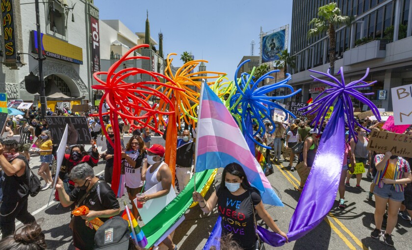 """People gather in Hollywood for an """"All Black Lives Matter"""" march, organized by black members of the LGBTQ+ community in the Hollywood section of Los Angeles Sunday, June 14, 2020. (AP Photo/Damian Dovarganes)"""