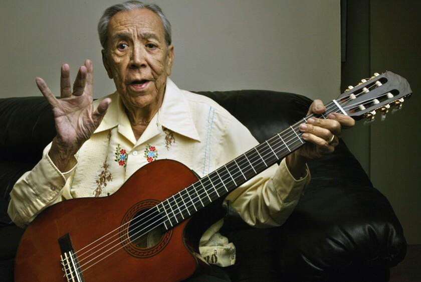 Lalo Guerrero, 87, plays his guitar.