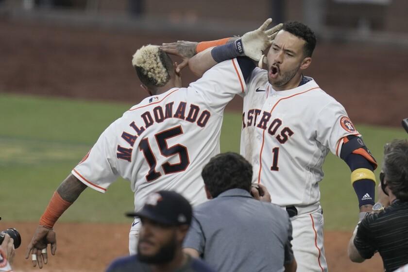 Houston Astros Carlos Correa's celebrates with Martin Maldonado.