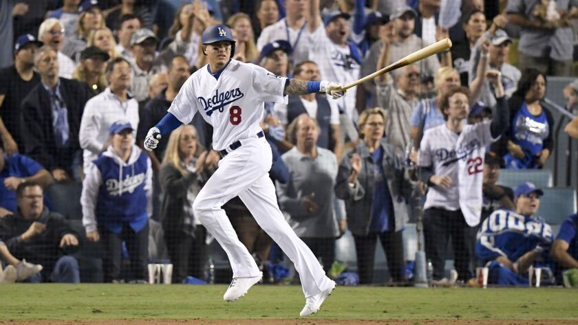 FILE - In this Oct. 26, 2018, file photo, Los Angeles Dodgers' Manny Machado watches his single agai