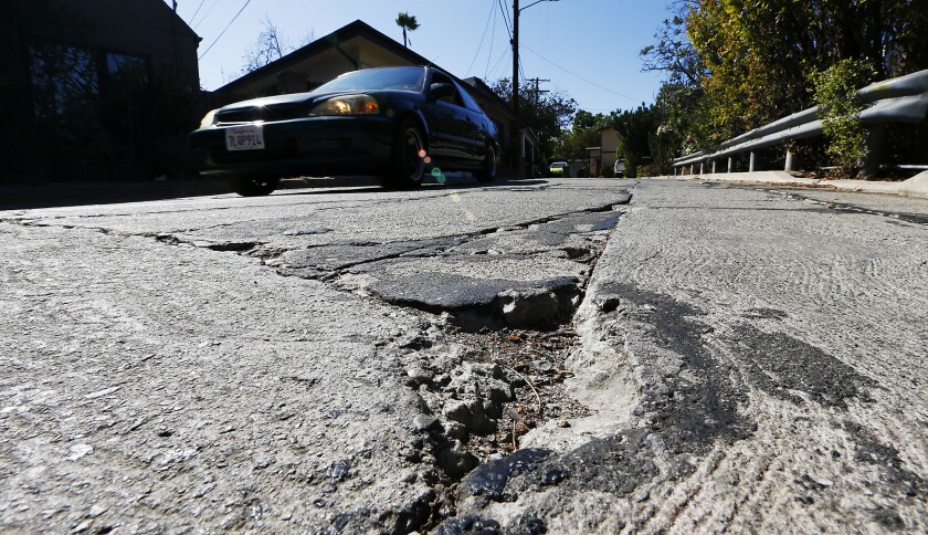 LOS ANGELES, CALIF. - AUG. 11, 2016. Crane Boulevard in Mount Washington is a deeply rutted street t