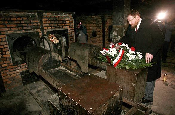 Piotr Cywinski, director of the Auschwitz-Birkenau Memorial and Museum, lays a wreath at the crematorium furnace during ceremonies marking the 64th anniversary of the liberation of former Nazi death camp Auschwitz in Oswiecim, Poland. In 2005, the United Nations General Assembly declared Jan. 27 to be International Holocaust Remembrance Day.