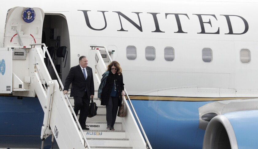 United States Secretary of State Mike Pompeo and his wife Susan Pompeo walk out of the plane upon arriving at Ciampino military airport, in Rome, Tuesday, Oct. 1, 2019. Pompeo is in Italy for a 3-day trip. (AP Photo/Andrew Medichini)