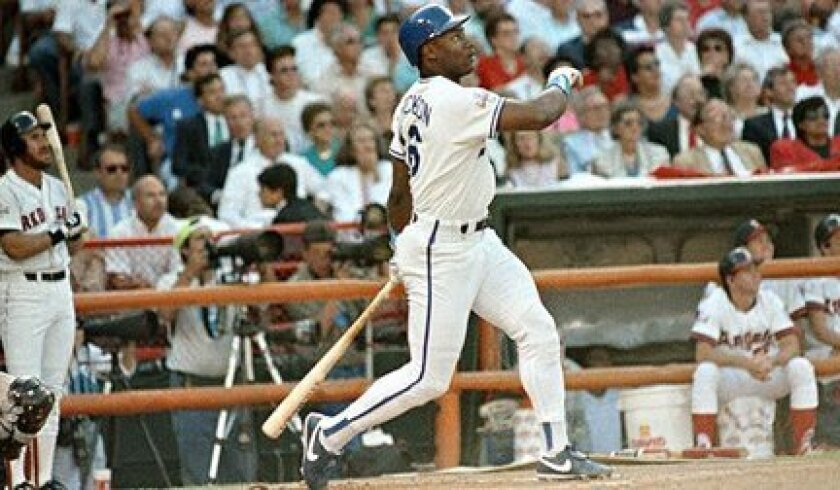 Kansas City's Bo Jackson follows the flight of his first-inning home run in the 1989 All-Star Game at Anaheim Stadium.