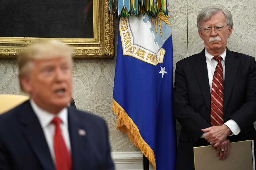 John Bolton listens as President Trump speaks to the news media on July 10, 2019