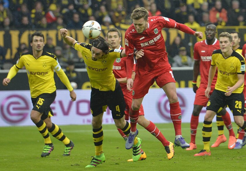 Hannover's Andre Hoffmann, right, and Dortmund's Neven Subotic challenge for the ball during the German Bundesliga soccer match between Borussia Dortmund and Hannover 96  in Dortmund, Germany, Saturday, Feb. 13, 2016. (AP Photo/Martin Meissner)