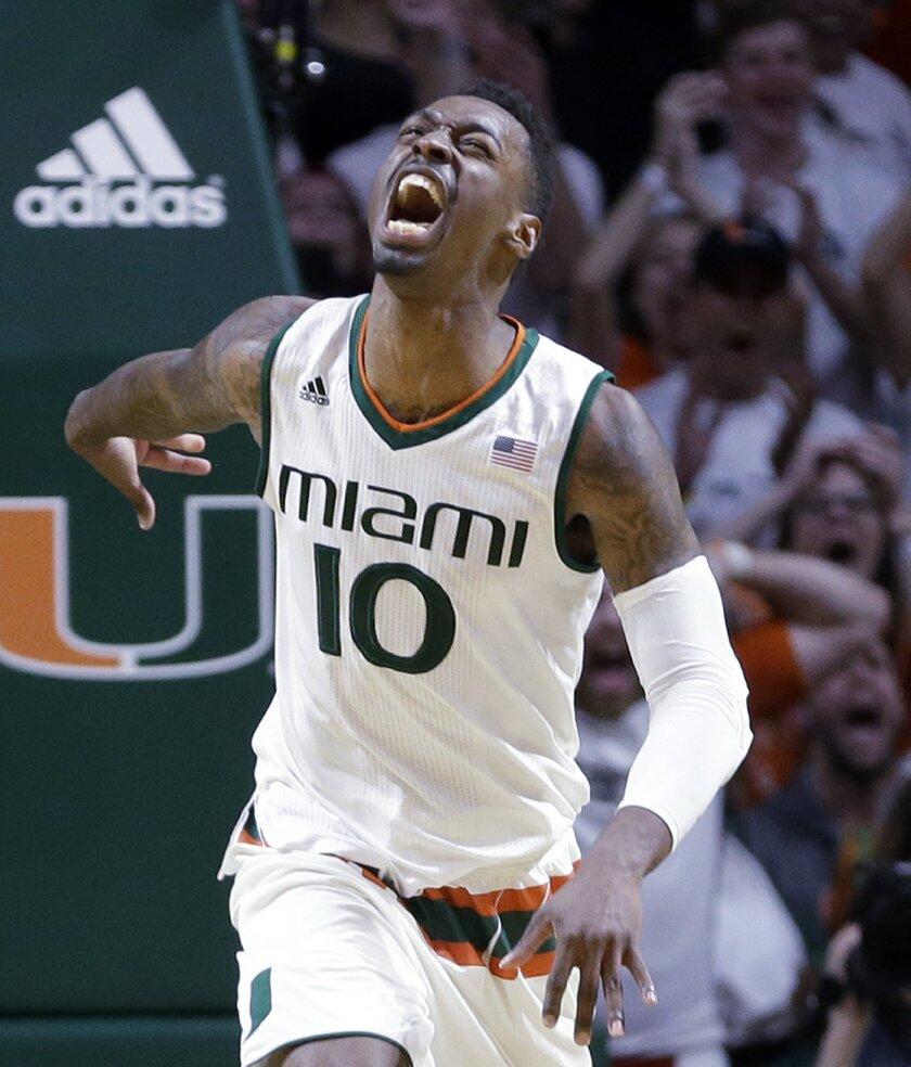 Miami guard Sheldon McClellan (10) celebrates after scoring against Duke during the second half of an NCAA college basketball game, Monday, Jan. 25, 2016, in Coral Gables, Fla. Miami won 80-69. (AP Photo/Alan Diaz)
