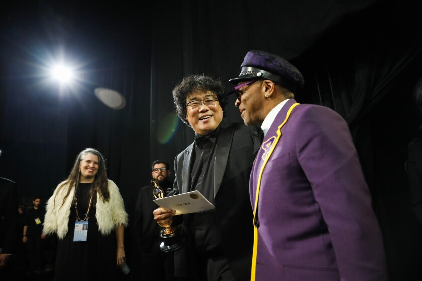 "Bong Joon Ho, whose film ""Parasite"" took home Oscars for best picture, international film, director and original screenplay, backstage with Spike Lee."