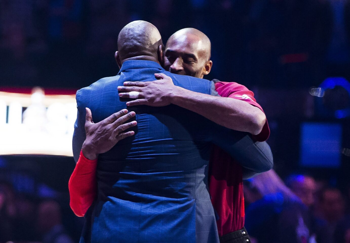 Western Conference's Kobe Bryant, of the Los Angeles Lakers, right, hugs Magic Johnson, left, as he is introduced before the first half of the NBA all-star basketball game, Sunday, Feb. 14, 2016 in Toronto. (Mark Blinch/The Canadian Press via AP) MANDATORY CREDIT