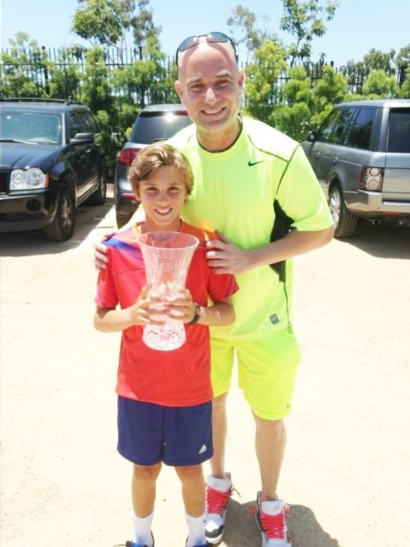 Hudson Rivera with Andre Agassi. Courtesy photo