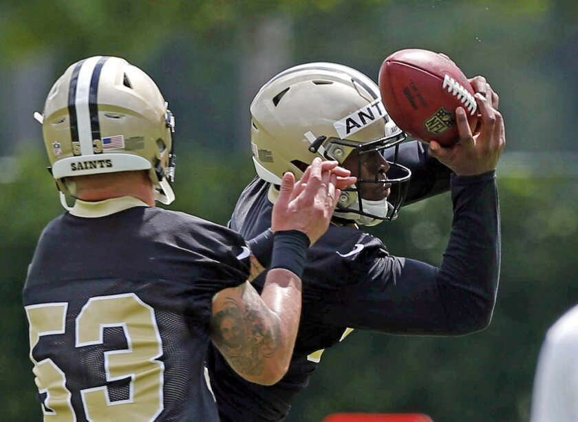 New Orleans Saints linebacker Stephone Anthony, right, goes through drills against linebacker James Laurinaitis (53) during NFL football practice in Metairie, La., Thursday, May 26, 2016. Anthony, a 2015 first-round pick who quickly took over as starting middle linebacker, is preparing for a positi