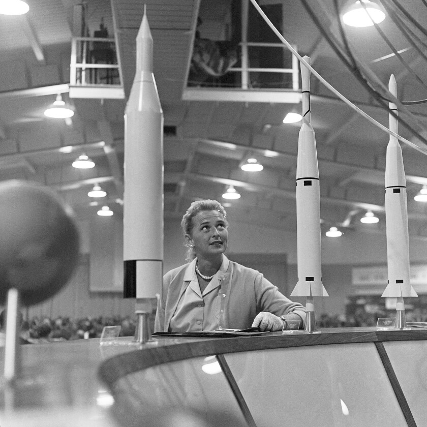 This May 26, 1961 photo shows Jerrie Cobb with a display of rockets at a national conference where the leading space experts gathered in Tulsa, Okla. Cobb died in Florida at the age of 88 on March 18, 2019.