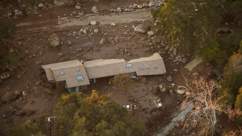 A home in the Romero Canyon area is surrounded by mud and debris in Montecito in an aerial view from a California National Guard Blackhawk Helicopter used for hoist rescues of victims of the mud and debris flows in Montecito.