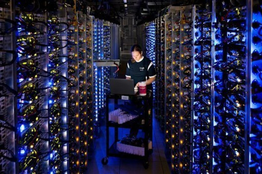 A Google technician inside a Dalles, Ore., data center. Cloud computing companies seeking out 100 percent renewable energy have been stymied by current regulations and markets.