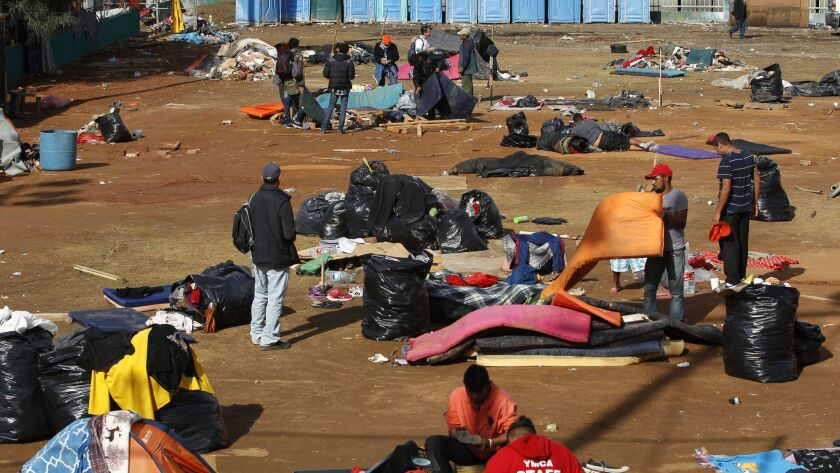 TIJUANA, December 1, 2018 | The remaining Central American migrants pack up their belongings on a ba