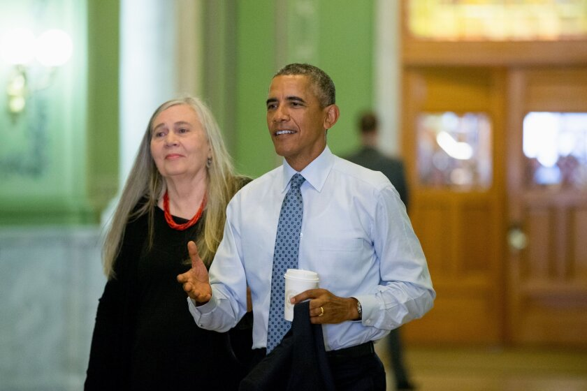 President Obama with author Marilynne Robinson. Obama asked the writer if she thinks Americans don't read enough novels.