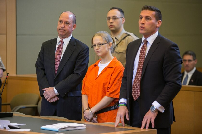 Angelika Graswald stands in court with her attorneys Jeffrey Chartier and Richard Portale at her arraignment in Goshen, N.Y, on Friday, May 29, 2015. Graswald is accused of killing Vincent Viafore, her fiance on the Hudson River by sabotaging his kayak (Allyse Pulliam/Times Herald-Record via AP, Pool)