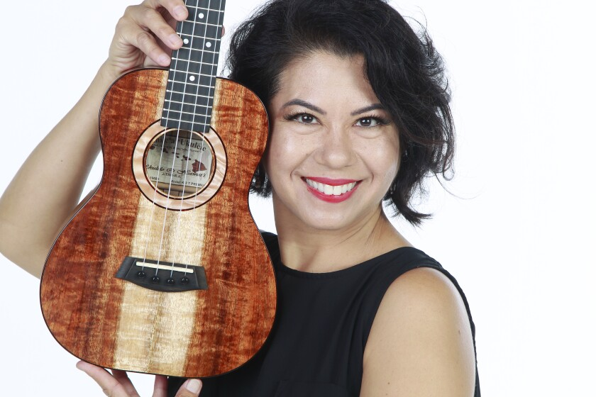 Robin Sassi is the owner of San Diego Music Studio in San Marcos, which was recently recognized with the Music Makes a Difference award from the National Association of Music Merchants for her Philippines Ukulele Project, providing instruments and music lessons to children in the Philippines.