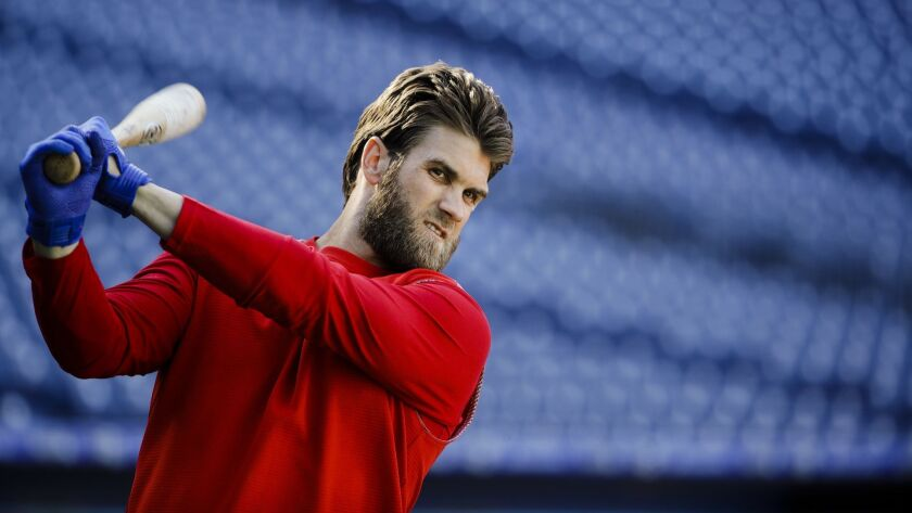 Philadelphia Phillies outfielder Bryce Harper warms up before batting practice.