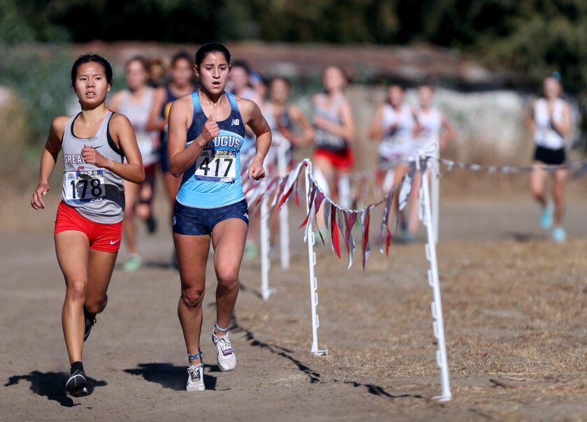 Saugus sophomore Isabella Duarte, right, and Great Oak senior Audrey Dang navigate the Riverside City Cross-Country Course during the Southern Section Division 1 championships on Nov. 23, 2019.