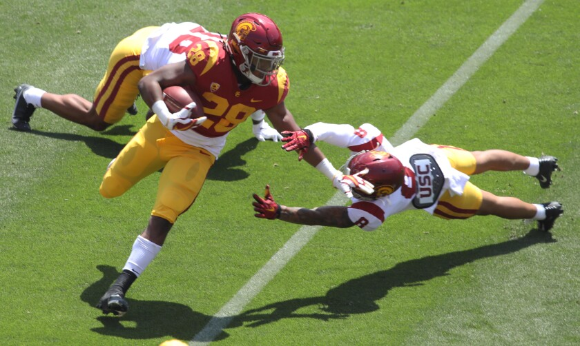 Running back Keaontay Ingram carries the ball past defensive back Chris Steele (8) during the USC spring game April 17, 2021.