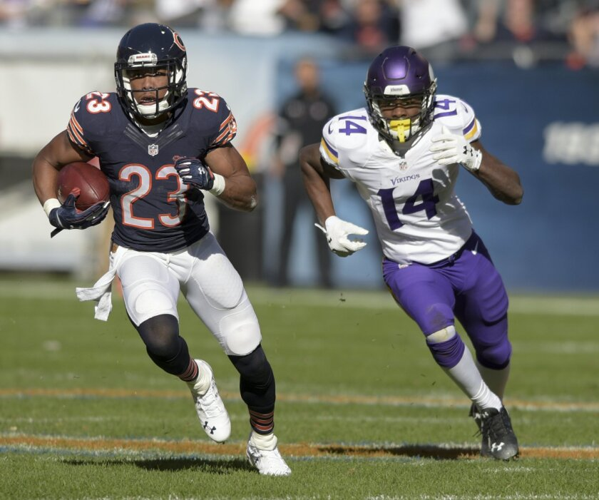 Chicago Bears cornerback Kyle Fuller (23) is chased down by Minnesota Vikings wide receiver Stefon Diggs (14) during an NFL football game in Chicago, Sunday, Nov. 1, 2015. (Mark Black/Daily Herald via AP) MANDATORY CREDIT; MAGAZINES OUT