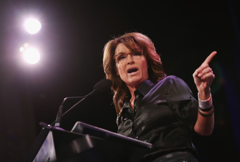Sarah Palin, shown in January, took to Facebook on Thursday night to defend Curt Schilling and his controversial tweet.