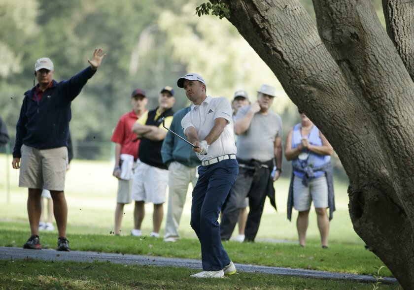 Martin Laird of Scotland hits off the 16th fairway of the Silverado Resort North Course during the second round of the Frys.com PGA Tour golf tournament Friday, Oct. 10, 2014, in Napa, Calif. Laird shot 5-under-par 67 to finish at total 10-under-par. (AP Photo/Eric Risberg)
