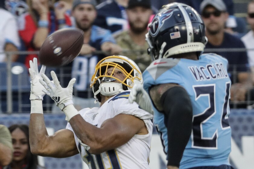 Chargers running back Austin Ekeler (30) beats Tennessee Titans strong safety Kenny Vaccaro (24) for a long touchdown pass during fourth quarter action on Sunday in Nashville, Tenn.