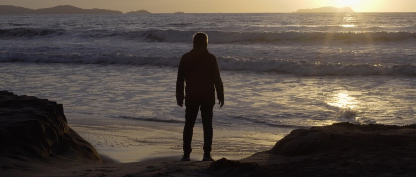 "A man looks out toward the ocean in a scene from ""Maija Awi,"" screening at the San Diego Latino Film Festival."