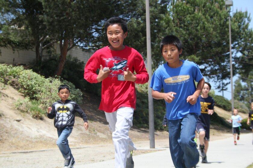 Ashley Falls students run in the school's Mileage Club.