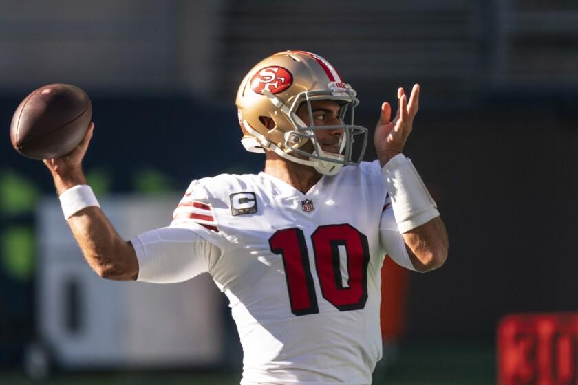 San Francisco 49ers quarterback Jimmy Garoppolo looks to pass during warmups.