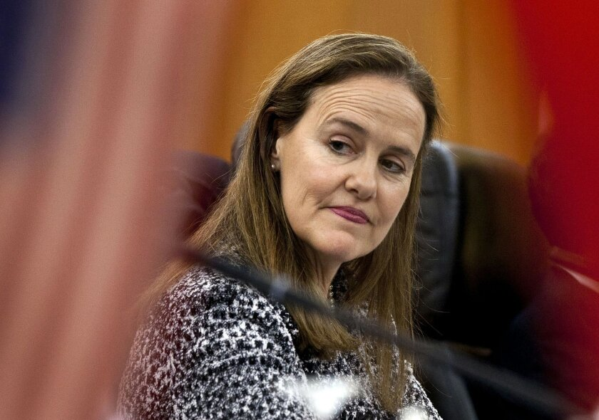 FILE - This Dec. 7, 2011 file photo shows former U.S. Defense Undersecretary Michele Flournoy, preparing for a bilateral meeting in Beijing, China. Flournoy, formerly the Pentagon's policy chief and among President Obama's more hawkish advisers, could be in line to become the first woman to lead th
