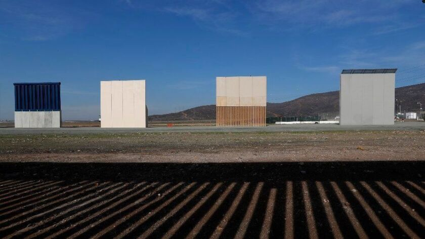 Border wall prototypes stand in San Diego near the U.S.-Mexico border on Dec. 12, 2018.