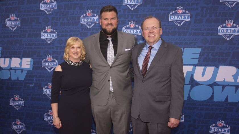 Ryan Ramczyk poses for a picture with his mother, Lori, and father, Randy, on the red carpet prior to the start of the NFL Draft.