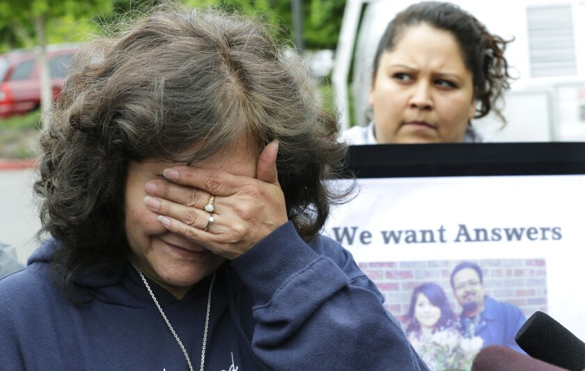 Marilyn Covarrubias, left, talks with reporters on May 11, 2015, outside police headquarters in Lakewood, Wash. The interim police chief says officers shot and killed her son Daniel in a lumber yard last month because he pointed a cellphone at them as though it were a gun. At right is Lanna Covarrubias, Daniel's sister.
