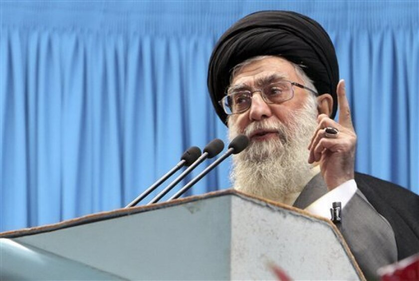 "In this photo released by an official website of the Iranian supreme leader's office, Iranian supreme leader Ayatollah Ali Khamenei, delivers Friday prayers sermon, at the Tehran University campus, Iran, Friday, Feb. 3, 2012. Iran will help any nation or group that confronts the ""cancer"" Israel, Ayatollah Ali Khamenei said Friday. He also said in remarks delivered to worshippers at Friday prayers in Tehran and broadcast on state TV that the country would continue its controversial nuclear program, and warned that any military strike by the U.S. would only make Iran stronger. (AP Photo/Office of the Supreme Leader)"