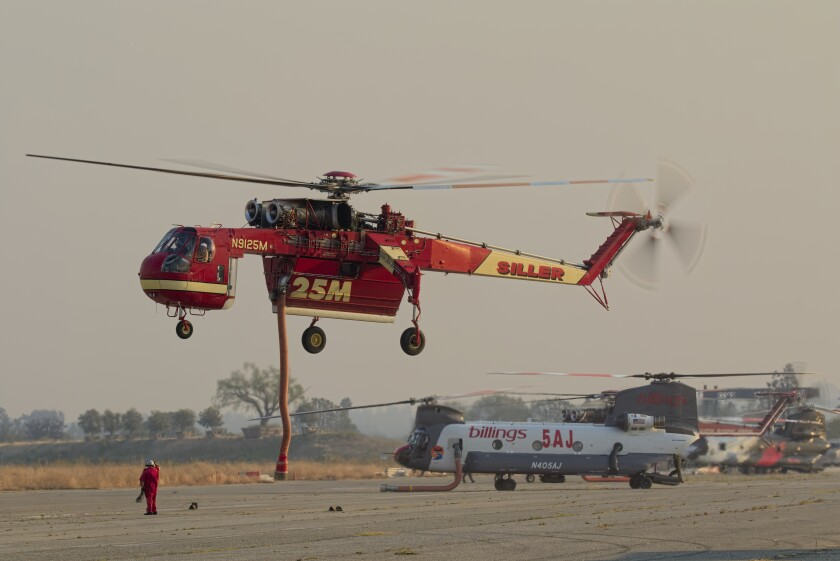 A Siller Helicopters' Sikorsky CH-54A Skycrane lands at El Toro.
