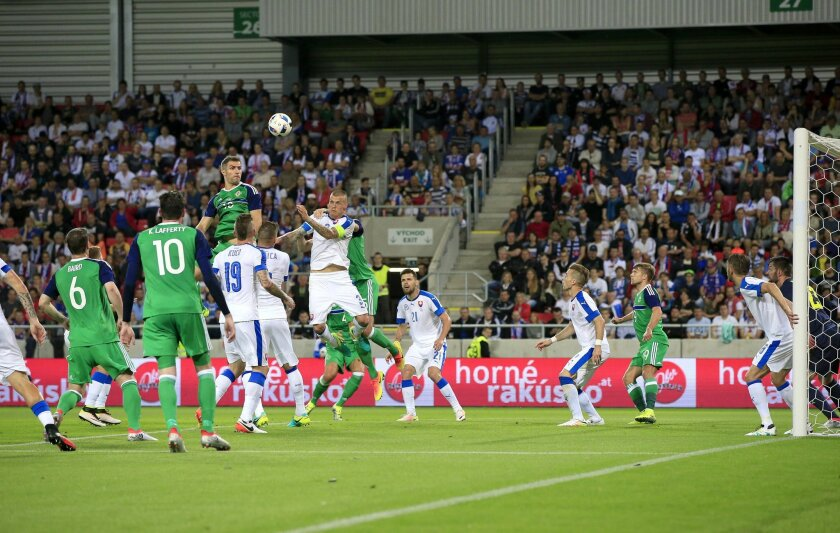 Northern Ireland's Aaron Hughes heads on goal during the International Friendly soccer match against Slovakia at the Antona Malatinskeho Stadium, Trnava, Slovakia, Saturday, June 4, 2016. (Jonathan Brady/PA via AP) UNITED KINGDOM OUT