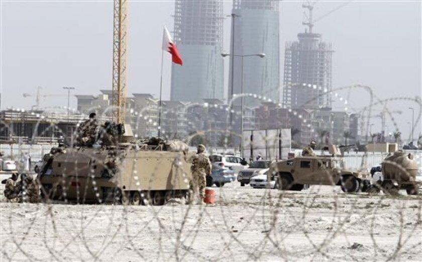 Bahraini army vehicles occupy Pearl Square, behind razor wire in Manama, Bahrain, Friday, Feb. 18, 2011.(AP Photo/Hassan Ammar)