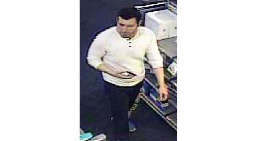 Surveillance footage of a man suspected of stealing 55 laptop computers from UCLA.