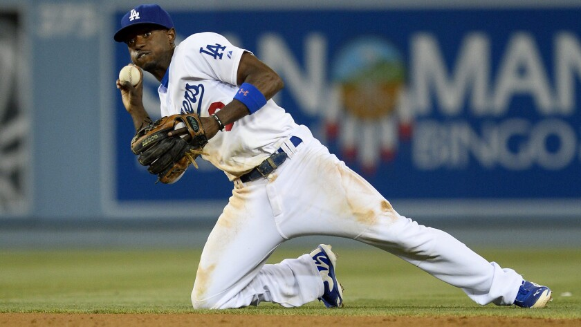 Dodgers second baseman Dee Gordon throws from his knees during a game against the Chicago White Sox in June. Gordon was named a National League All-Star for the first time Sunday.