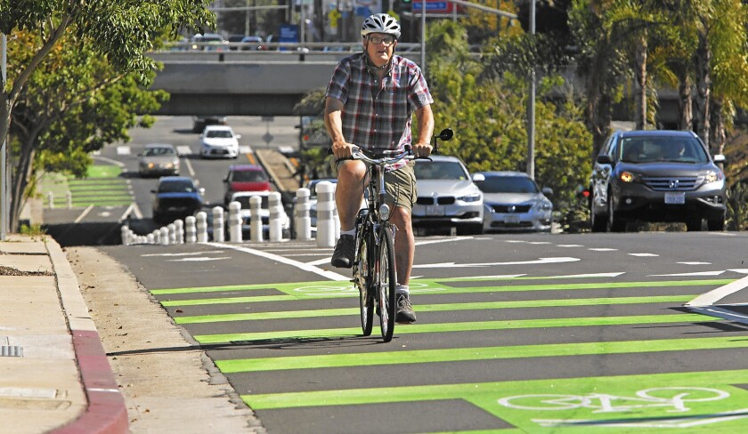 Brent Butterworth rides his bike on a protected bike lane on Reseda Boulevard. Officials say Mobility Plan 2035 will get people out of their cars.