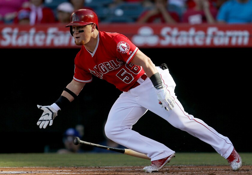 Angels right fielder Kole Calhoun bats against the Athletics during a game at Angel Stadium on Sept. 30.