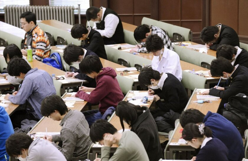 Students take the National Center Test for University Admissions at the University of Tokyo earlier this year. Students from Shanghai, Hong Kong, Singapore, Taiwan, Japan and South Korea were among the highest-ranking groups in math, science and reading in test results released last week by the Program for International Student Assessment.