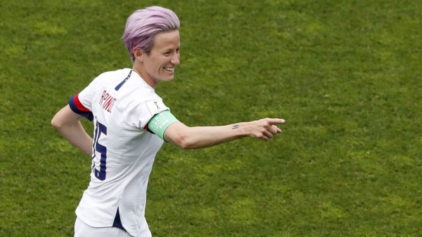 United States' Megan Rapinoe celebrates after scoring her side's first goal from the penalty spot du